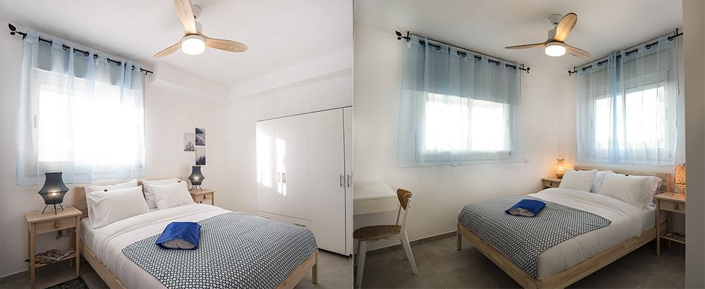 מבט לחדרי שינה זוגיים בדירת נופש